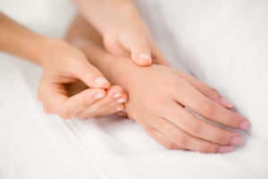 Acupuncturist applies needles in hand,, via Fort Saskatchewan Acupuncture